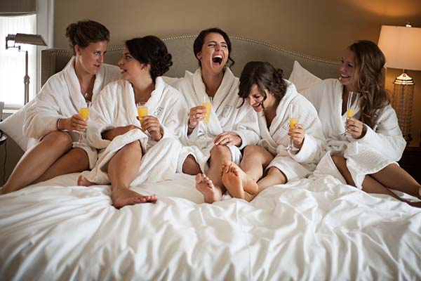 Wedding photography Bridal Party laughing in bed
