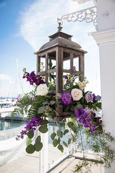 Beach Side Floral Arrangement hanging in a Lantern