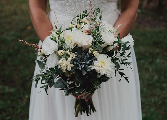 Bride Holding Wedding Bouquet with White Flowers