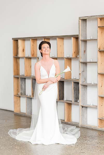 Photo of Bride Holding White Flower