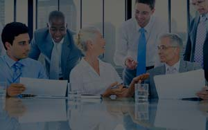 Corporate Team collaborating at conference room table