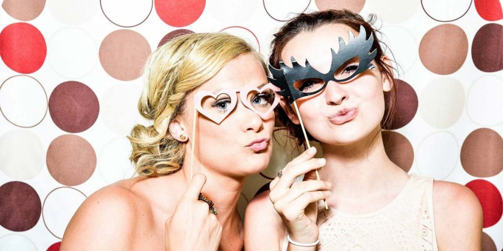 Close Up of Two Girls Posing for Photo Booth