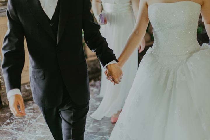 Bride & Groom Holding Hands