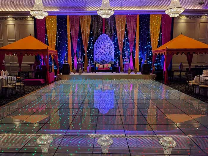 LED Dance Floor set up in venue with red decor accents