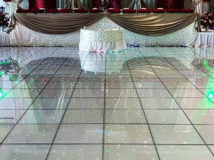 LED Dance Floor set up in venue with white accents