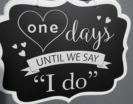 Chalkboard sign with 1 day until wedding