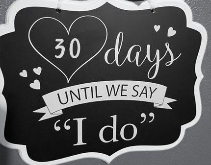 Chalkboard sign with 30 days until wedding