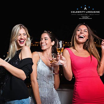 Group of Women Laughing holding drinks