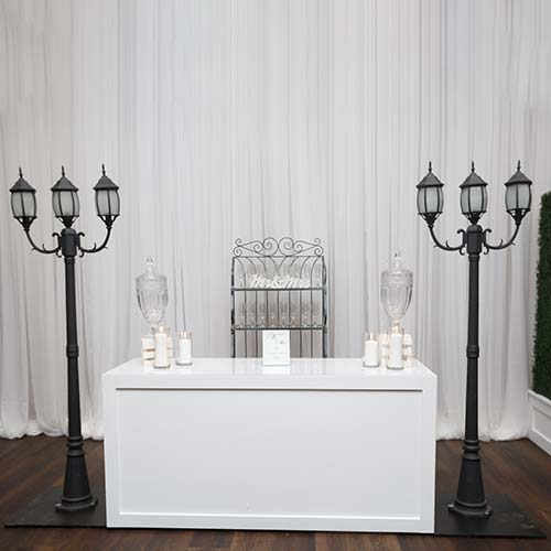 White Portable Bar with Vintage Light Stands on either side