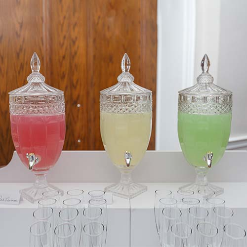 3 crystal beverage dispensers with juice