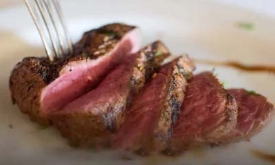 Steak Being Cut on a Plate