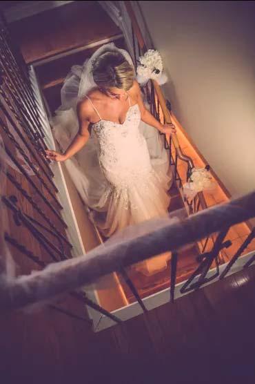 Bride descending stairway